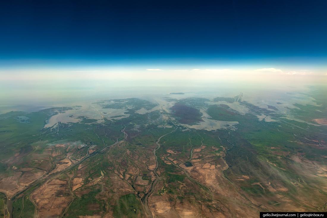 Фотографии из окна самолёта Дельта Волги